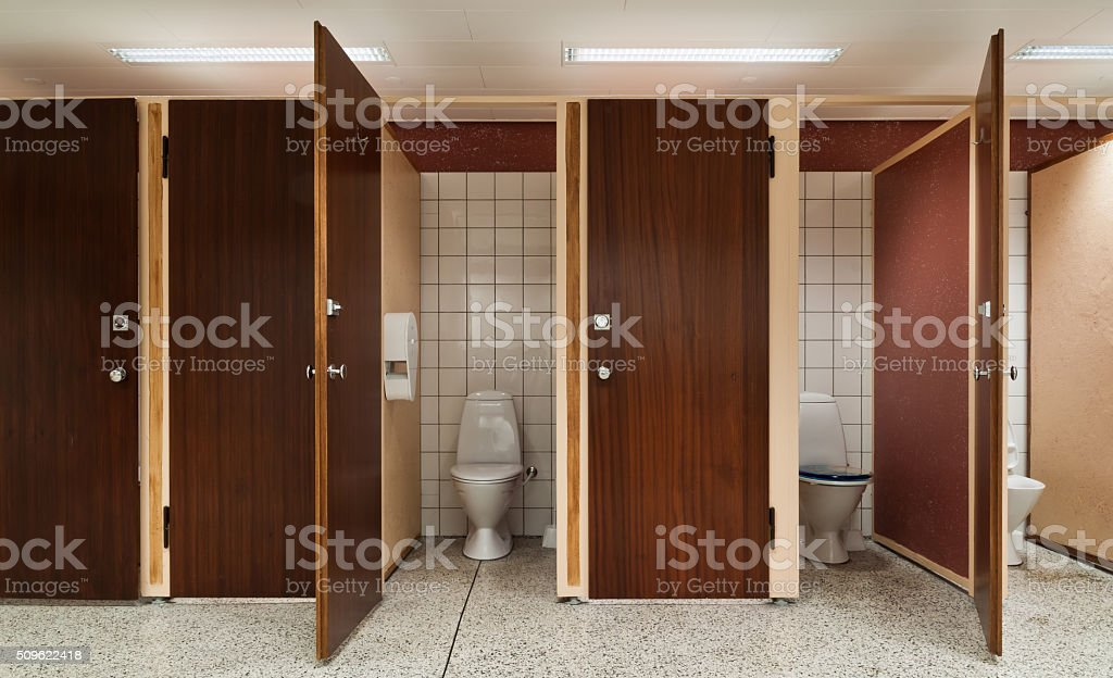 Row of public toilets stock photo