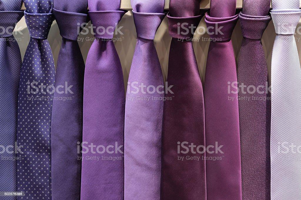 row of purple necktie stock photo