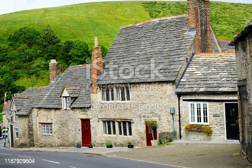 Corfe, Dorset, UK - 14th June, 2019: A row of pretty country cottages built with local limestone. Corfe is famous for it's medieval castle which was destroyed in the English Civil War.