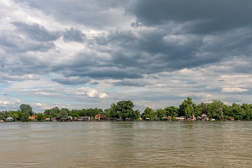 New Belgrade, Serbia - May 29, 2021: A row of rafts houses moored to the riverbank Sava near Belgrade.