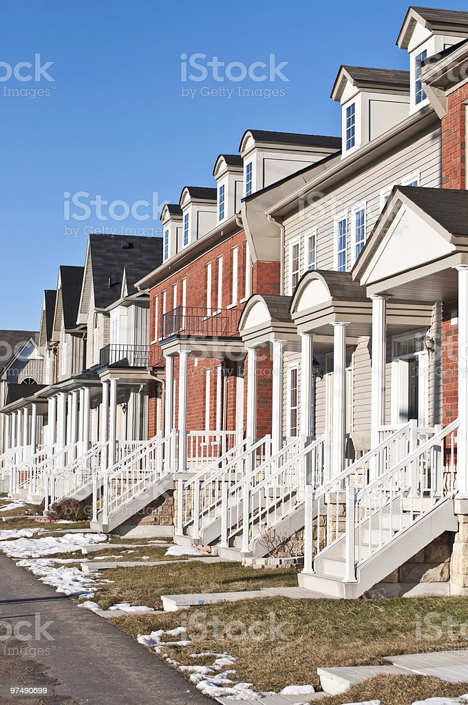Row of Recently Built Townhouses on a Suburban Street royalty-free stock photo