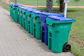 istock Row of Recycle Bins and Garbage Can 691672970
