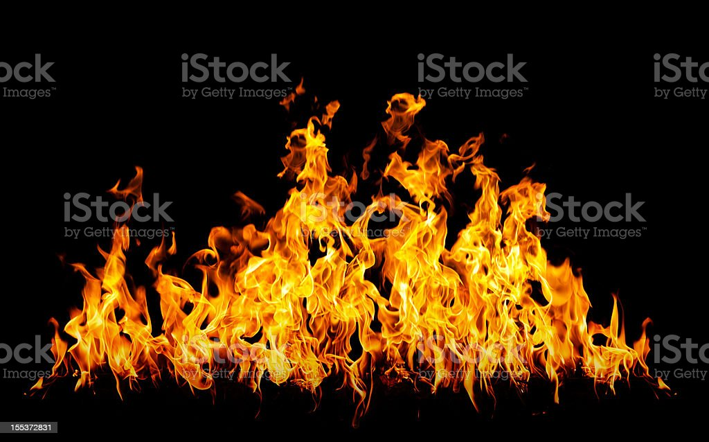 Row of red and orange flames on a black background royalty-free stock photo