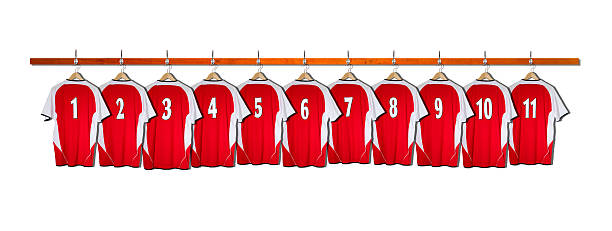 Row of Red and White Football Shirts Row of Red and White Football Shirts all hanging on hangers on Bar 1-11 american football uniform stock pictures, royalty-free photos & images