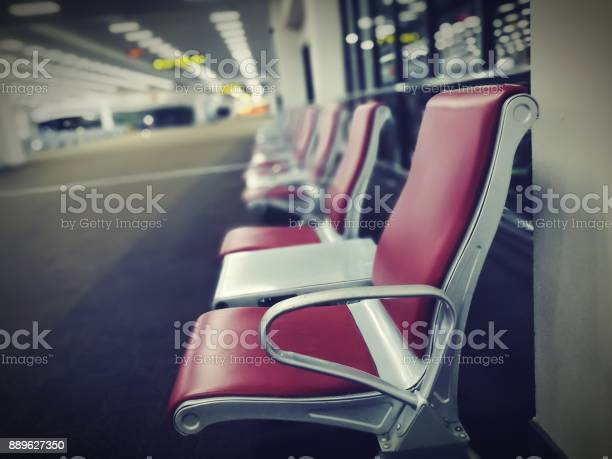 Row Of Red Chairs Installed On Carpet Floor Leisure Seating For Relaxing Or Waiting Shared Table Between Two Seats Stock Photo Download Image Now Istock