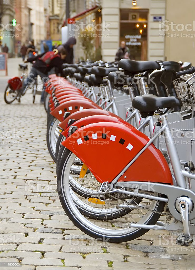 Row of red city bicycles stock photo
