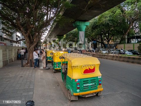 BANGALORE, INDIA - NOVEMBER 19, 2019: Row of rickshaw taxis on the side of the street waiting for passengers