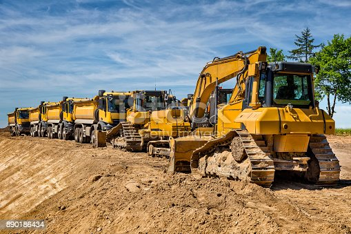 Row of road construction machinery on the construction of highway S6, Koszalin, Poland