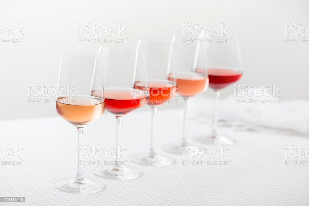 Row of Rose Wine Glasses stock photo