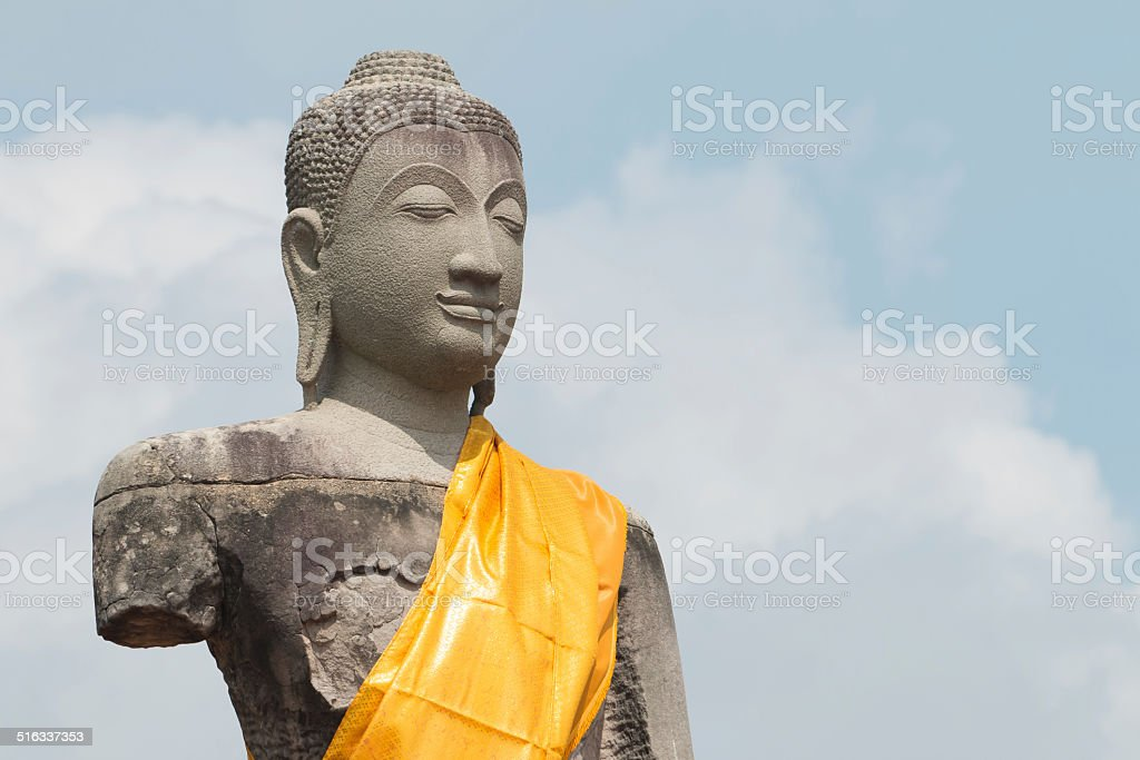 row of ruin buddha statue in wat chai wattanaram stock photo