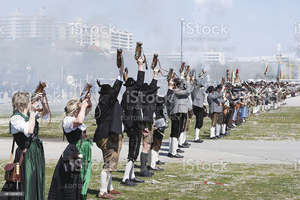 salute shooters in traditional bavarian costumes celebrate the 850th...