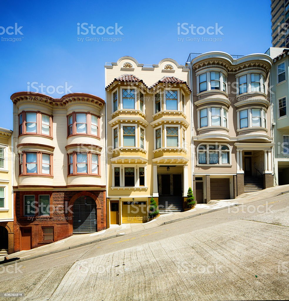 Row of San Francisco townhouses built on steep hill stock photo