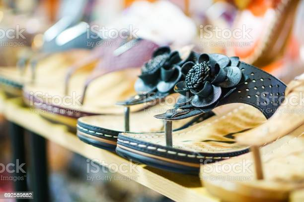 Row of sandals in a footwear shop picture id692589882?b=1&k=6&m=692589882&s=612x612&h=gpz7ym0gggb08iuty65g urk4nmiouza8ned348jvr8=