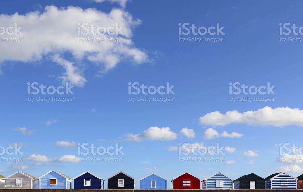 Row of seaside beach huts on the English coast royalty-free stock photo