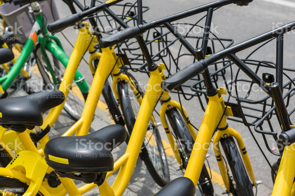row of service public rental bicycle stock photo