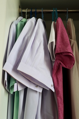 Row of shirt hanging in cabinet