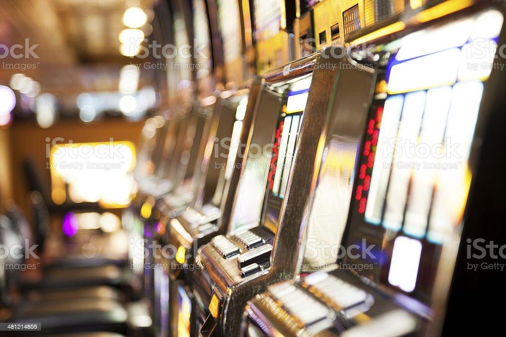 Row of  slot machines inside a casino stock photo