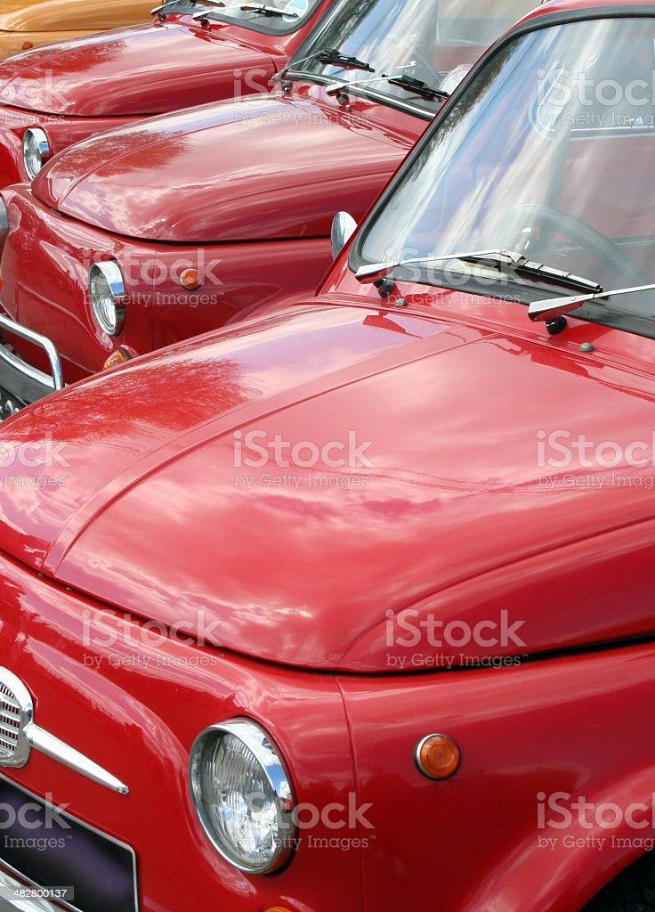 Row of small red Italian cars stock photo