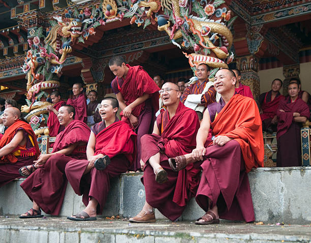 Row of Smiling Monks in Bhutan stock photo