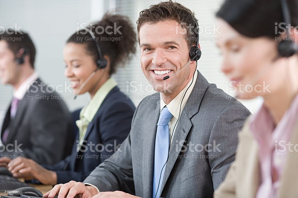 Row of smiling telephonists royalty-free stock photo