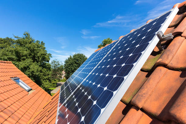 Row of solar panels  on roof at home stock photo