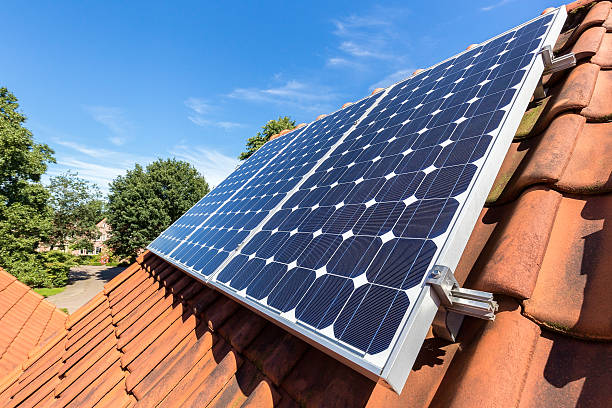 Row of solar panels  on roof stock photo