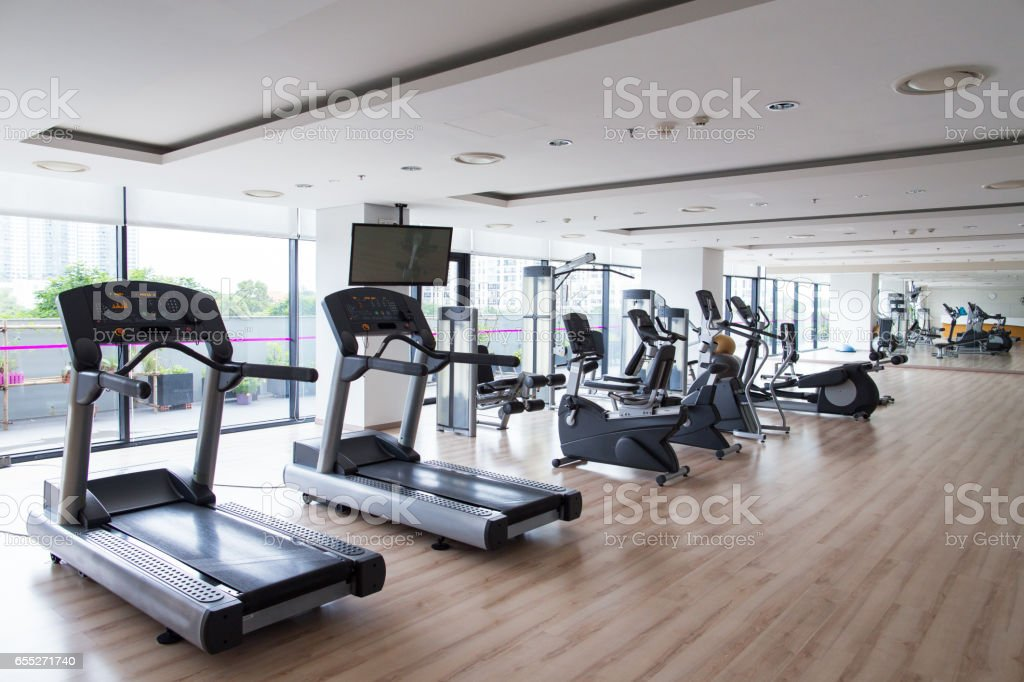 Row of sports equipment in fitness gym stock photo