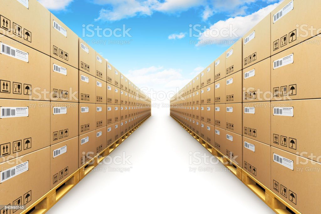 Row of stacked cardbaord boxes on shipping pallets stock photo