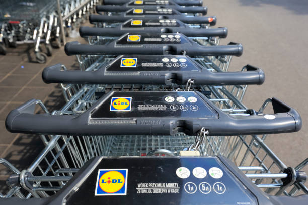 Row of stacked metal supermarket trolleys