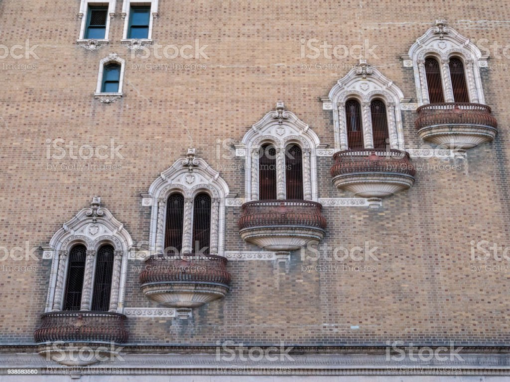 Row of staggered, rusty, outdoor balconies on the side of a building stock photo