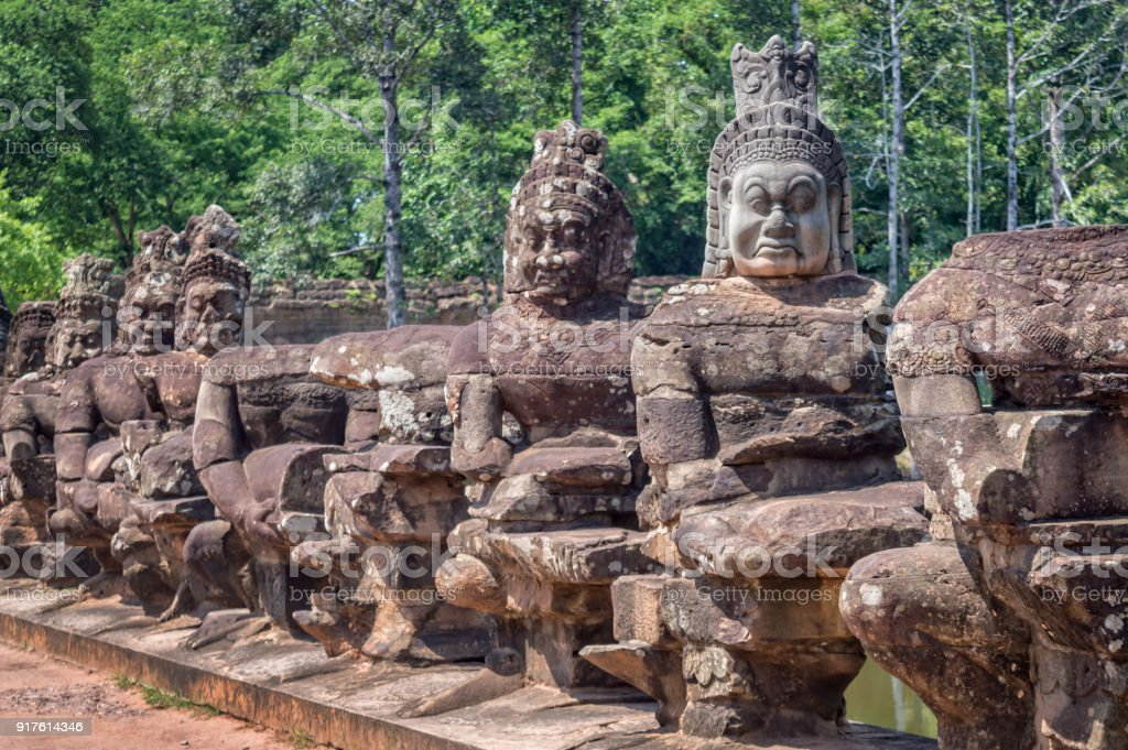 Row of statues at the entry gate of Angkor, Siem Rep, Cambodia stock photo