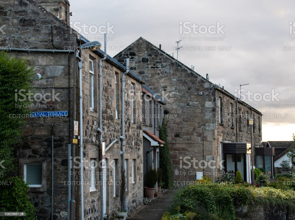 A row of stone cottages on Canal Terrace stock photo