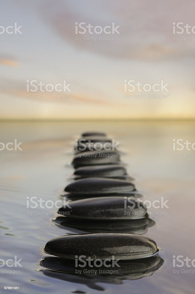 Row of stones in calm water . royalty-free stock photo