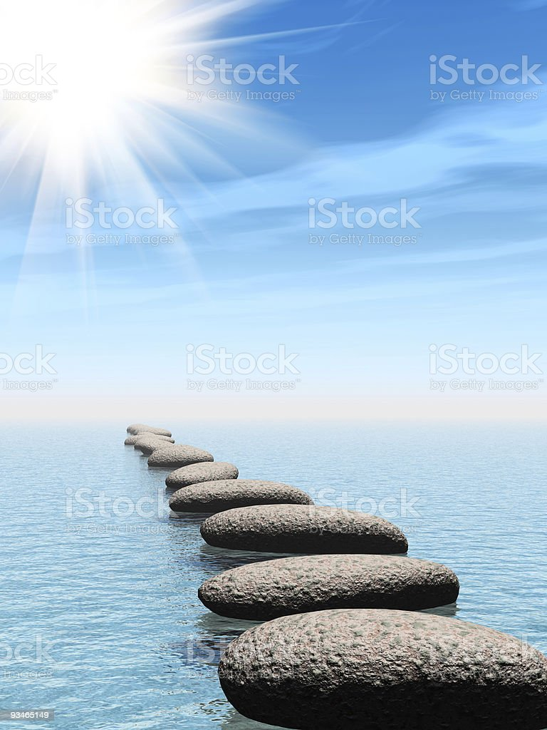 row of stones in water with sun beam royalty-free stock photo
