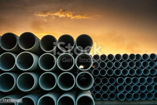 Row of Storage Sewage Drainage Concrete Pipeline, Manufacturing Plant of Material Construction, Stack of Culvert Pipe and Water Treatment System.