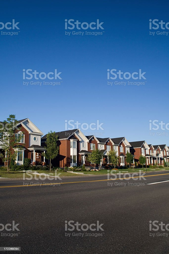 A row of suburban detached houses royalty-free stock photo