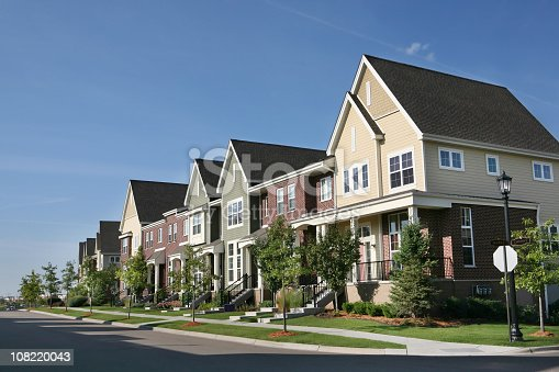 istock Row of Suburban Townhouses on Summer Day 108220043