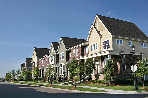 Row of Suburban Townhouses on Summer Day stock photo