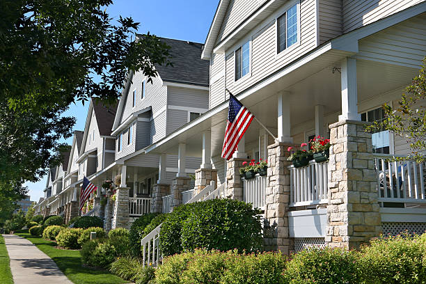 Row of Suburban Townhouses Perfectly manicured row of suburban townhouses on a beautiful summer day. townhouse stock pictures, royalty-free photos & images