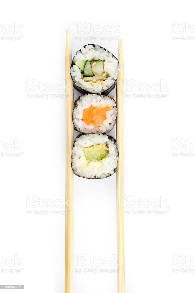 Row of sushi rolls with chopsticks stock photo
