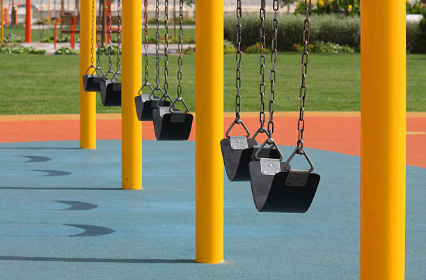 Row of swings in park near sea side at  Bahrain stock photo
