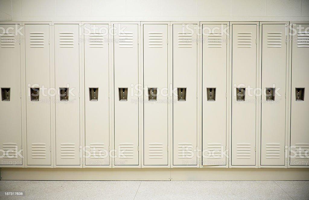 Row of tall white lockers in a white corridor stock photo