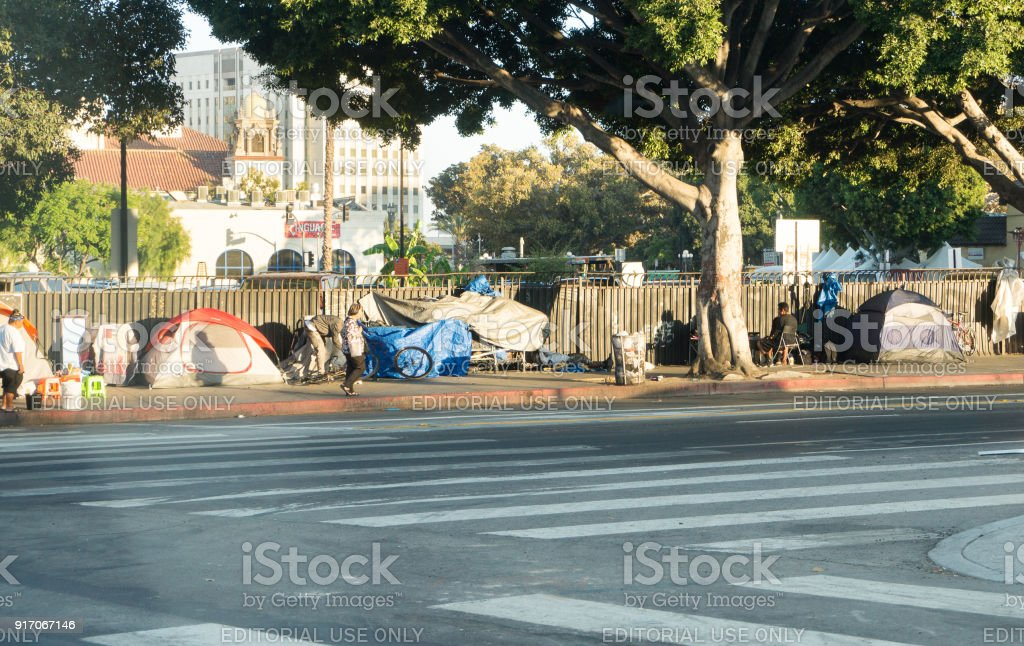 A row of tents and things of homeless people in Downtown LA. There are over 30 000 homeless living in the city of Los Angeles. stock photo