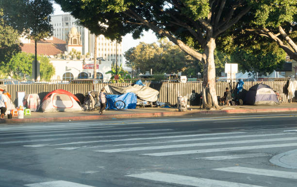 a row of tents and things of homeless people in downtown la. there are over 30 000 homeless living in the city of los angeles. - homelessness stock photos and pictures