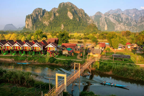 Row of tourist bungalows along Nam Song River in Vang Vieng, Vientiane Province, Laos stock photo