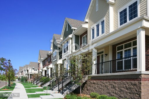 istock Row of Townhouses on Suburban Street 108221751