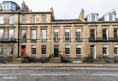 Exterior of Old Town houses with Colourful Wooden Front Doors at the top of a flight of steps in Edinburgh City Centre on a Cloudy Autumn Day