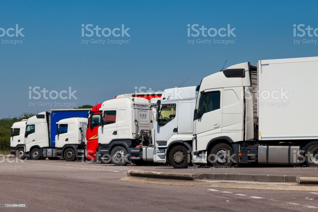 Row of trucks Row of trucks parked in a highway parking lot. Business Stock Photo