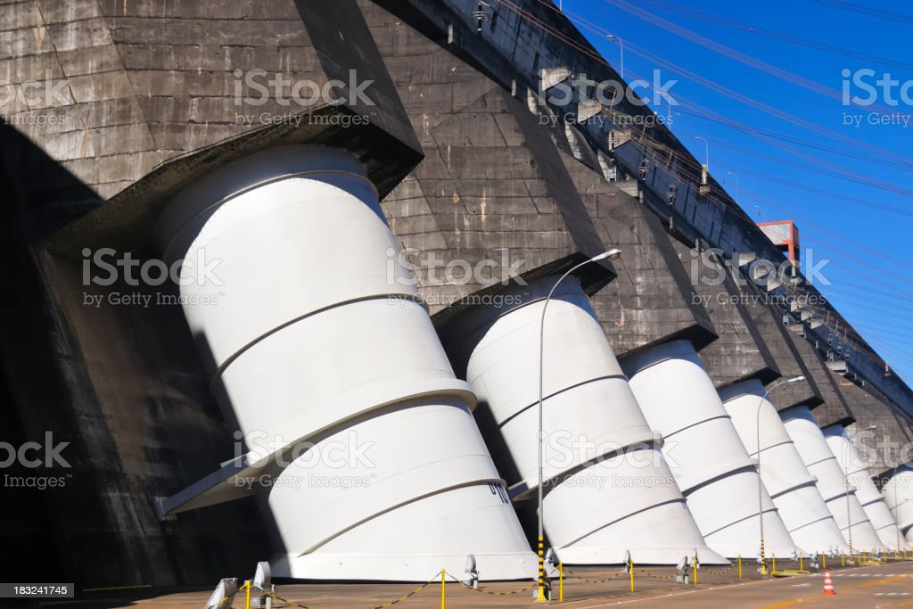 Row of turbine tubes on Itaipu dam stock photo