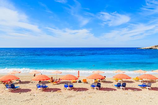 Row Of Umbrellas With Sunbeds On Petani Beach Kefalonia